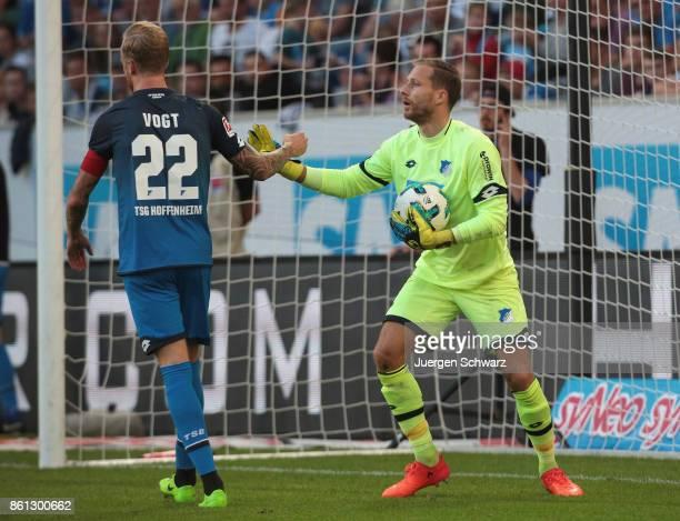 Goalkeeper Oliver Baumann of Hoffenheim gestures beside Kevin Vogt during the Bundesliga match between TSG 1899 Hoffenheim and FC Augsburg at Wirsol...