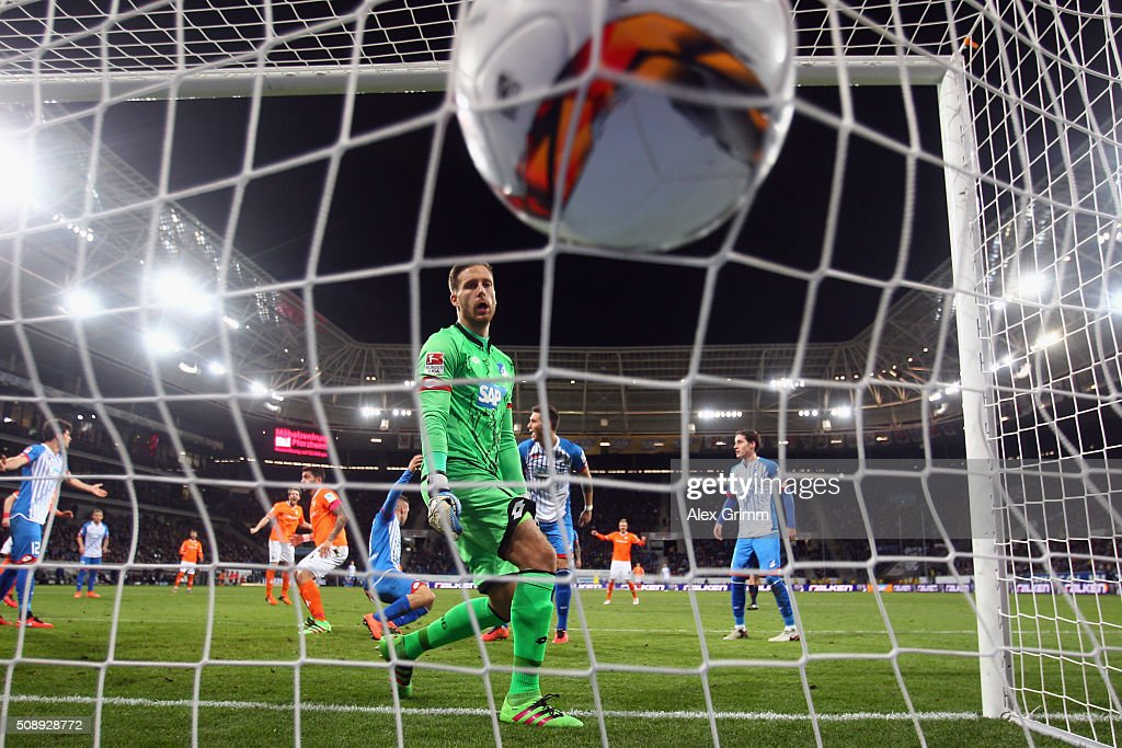 Goalkeeper <a gi-track='captionPersonalityLinkClicked' href=/galleries/search?phrase=Oliver+Baumann&family=editorial&specificpeople=4645207 ng-click='$event.stopPropagation()'>Oliver Baumann</a> of Hoffenheim lets in a goal from Aytac Sulu of Darmstadt during the Bundesliga match between 1899 Hoffenheim and SV Darmstadt 98 at Wirsol Rhein-Neckar-Arena on February 7, 2016 in Sinsheim, Germany.