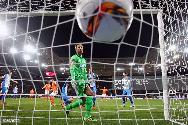 Goalkeeper Oliver Baumann of Hoffenheim lets in a goal from Aytac Sulu of Darmstadt during the Bundesliga match between 1899 Hoffenheim and SV...