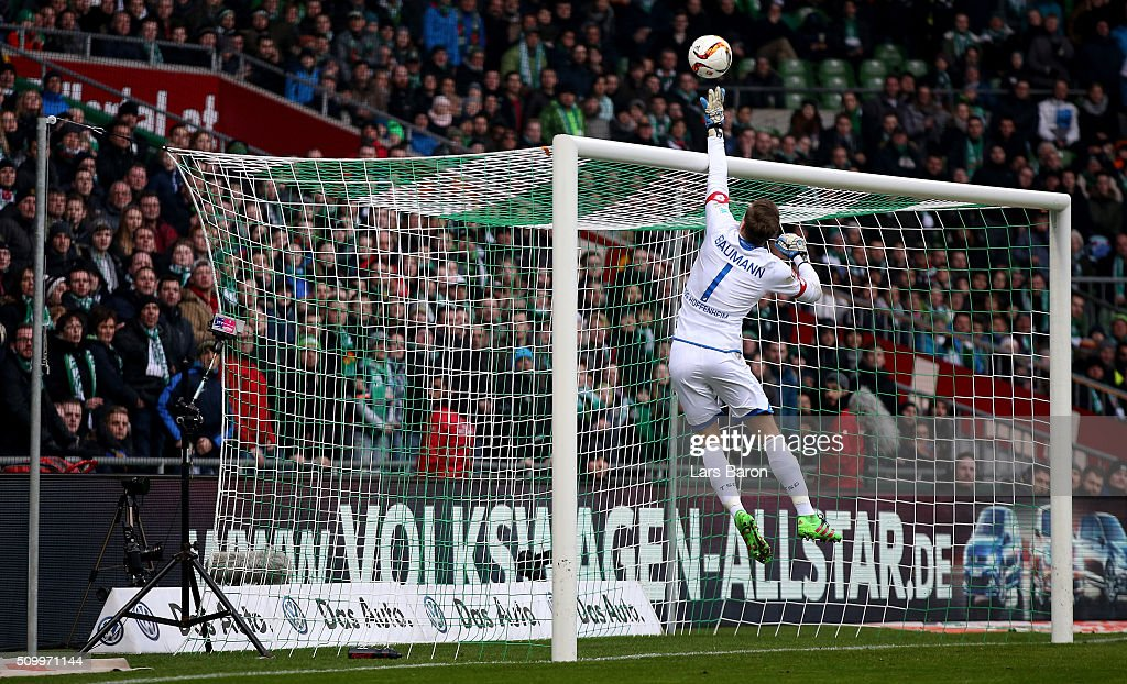 Goalkeeper <a gi-track='captionPersonalityLinkClicked' href=/galleries/search?phrase=Oliver+Baumann&family=editorial&specificpeople=4645207 ng-click='$event.stopPropagation()'>Oliver Baumann</a> of Hoffenheim saves a shot during the Bundesliga match between Werder Bremen and 1899 Hoffenheim at Weserstadion on February 13, 2016 in Bremen, Germany.