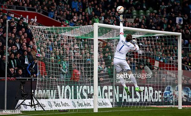 Goalkeeper Oliver Baumann of Hoffenheim saves a shot during the Bundesliga match between Werder Bremen and 1899 Hoffenheim at Weserstadion on...