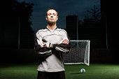 Goalkeeper on football pitch, portrait