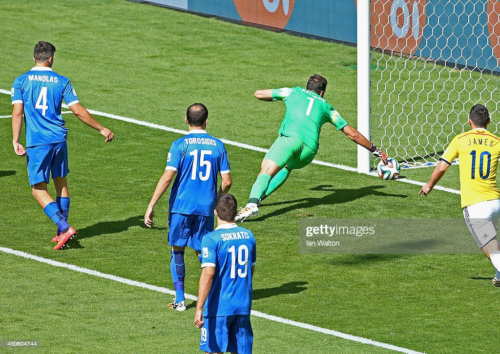 Goalkeeper <a gi-track='captionPersonalityLinkClicked' href=/galleries/search?phrase=Orestis+Karnezis&family=editorial&specificpeople=9475602 ng-click='$event.stopPropagation()'>Orestis Karnezis</a> of Greece watches as the ball crosses the line for a goal by Pablo Armero of Colombia (not pictured) during the 2014 FIFA World Cup Brazil Group C match between Colombia and Greece at Estadio Mineirao on June 14, 2014 in Belo Horizonte, Brazil.