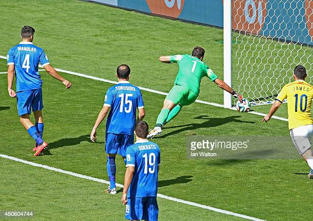Goalkeeper Orestis Karnezis of Greece watches as the ball crosses the line for a goal by Pablo Armero of Colombia during the 2014 FIFA World Cup...