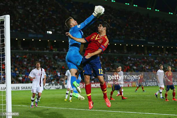 Goalkeeper Orjan Nyland Haskjold of Norway catches the ball ahead of Alvaro Morata of Spain during the UEFA European U21 Championship Semi Final...