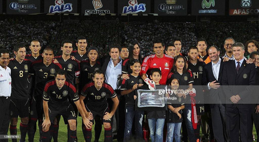 Goalkeeper, <a gi-track='captionPersonalityLinkClicked' href=/galleries/search?phrase=Oswaldo+Sanchez&family=editorial&specificpeople=213874 ng-click='$event.stopPropagation()'>Oswaldo Sanchez</a> (C) received an award for his 100 games with Mexico during a friendly match between Mexico National Team and Brasil National Team at the Georgia Dome on October 11, 2011 in Torreon, Mexico.