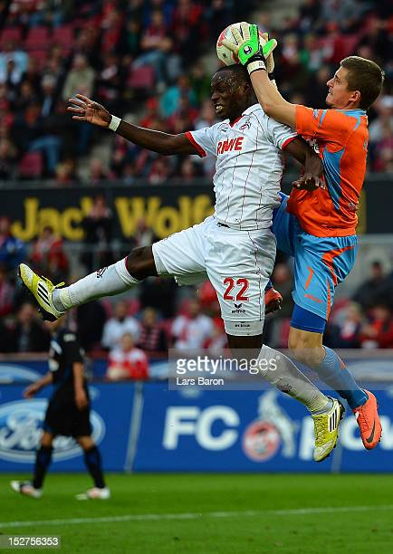 Goalkeeper Patric Klandt of Frankfurt goes up for a header with Anthony Ujah of Koeln during the Second Bundesliga match betweeen 1 FC Koeln and FSV...