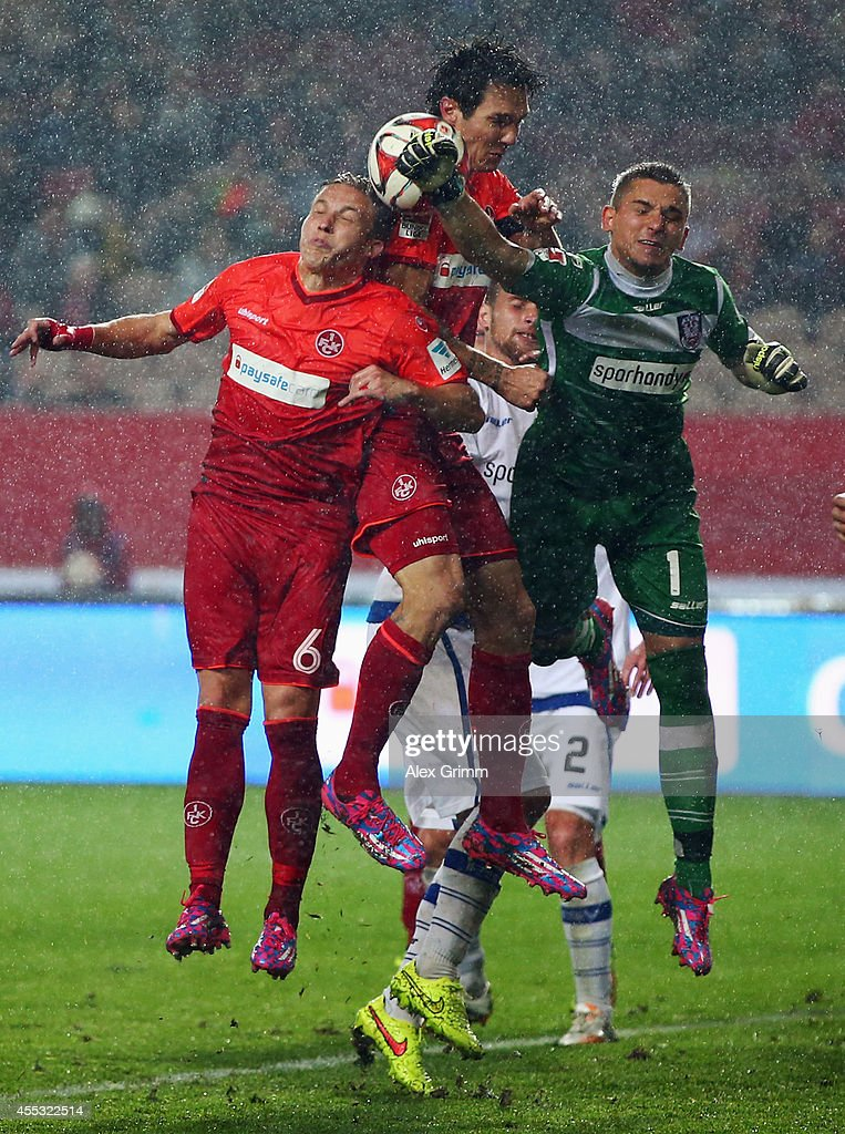 Goalkeeper Patric Klandt of Frankfurt is challenged by <a gi-track='captionPersonalityLinkClicked' href=/galleries/search?phrase=Srdjan+Lakic&family=editorial&specificpeople=1792938 ng-click='$event.stopPropagation()'>Srdjan Lakic</a> and <a gi-track='captionPersonalityLinkClicked' href=/galleries/search?phrase=Alexander+Ring&family=editorial&specificpeople=5588968 ng-click='$event.stopPropagation()'>Alexander Ring</a> (R-L) of Kaiserslautern during the Second Bundesliga match between 1. FC Kaiserslautern and FSV Frankfurt at Fritz-Walter-Stadion on September 12, 2014 in Kaiserslautern, Germany.