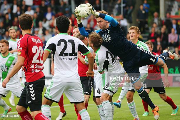 Goalkeeper Patrick Drewes of Wolfsburg catches the ball during the Third Bundesliga Playoff first leg match between SG Sonnenhof Grossaspach and VfL...