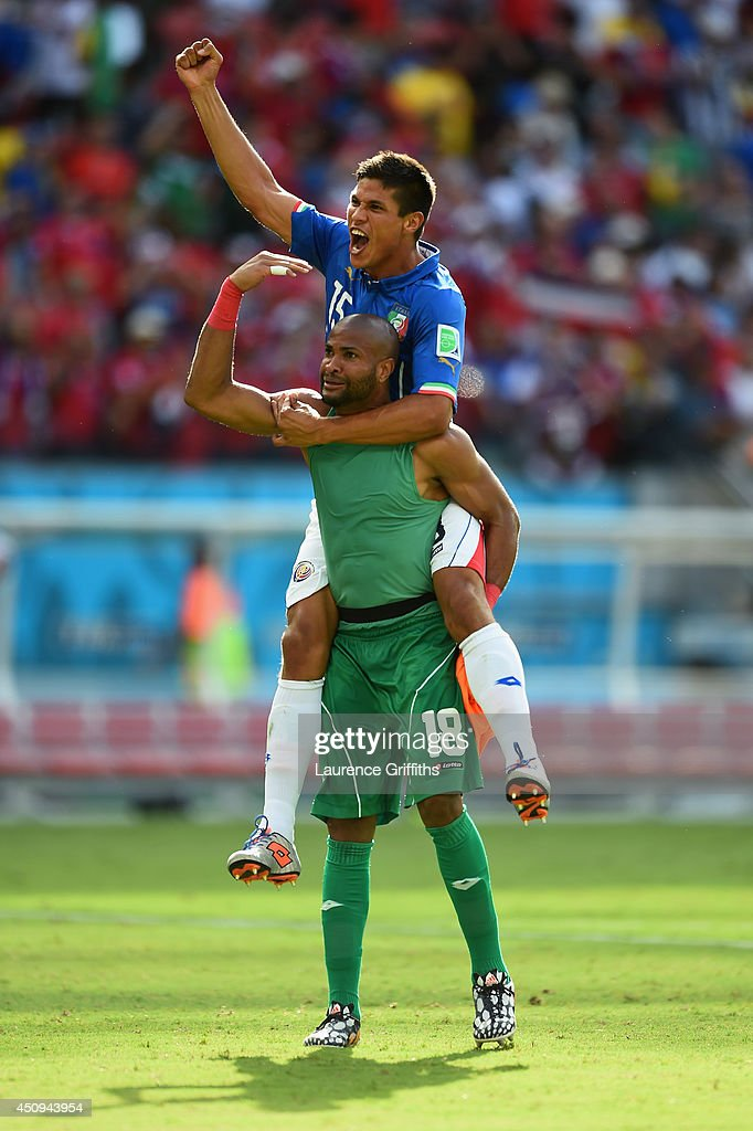 Goalkeeper Patrick Pemberton of Costa Rica celebrates with teammate Oscar Granados after defeating Italy 1-0 during the 2014 FIFA World Cup Brazil Group D match between Italy and Costa Rica at Arena Pernambuco on June 20, 2014 in Recife, Brazil.