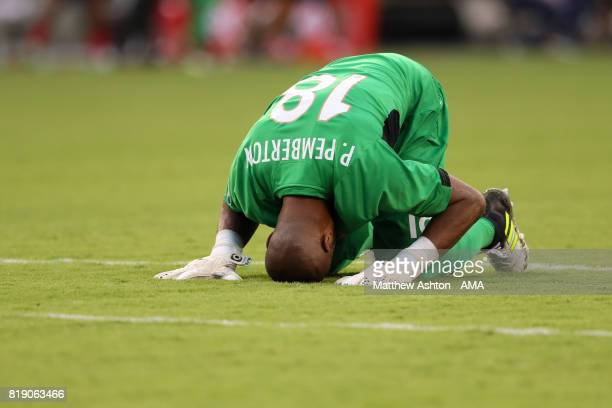 Goalkeeper Patrick Pemberton of Costa Rica kisses the ground as he celebrates after his team scored a goal to make it 10 during the 2017 CONCACAF...