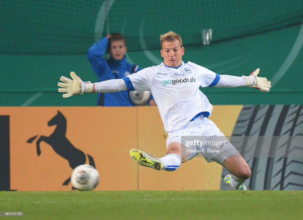 Goalkeeper Patrick Platins of Bielefeld receives the first goal during the DFB Cup match between Arminia Bielefeld and Bayer 04 Leverkusen at Schueco Arena on September 24, 2013 in Bielefeld, Germany.