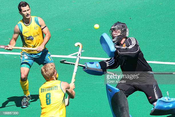 Goalkeeper Patrick Smith of England stops the ball from Matthew Butturini of Australian as his teammate Jamie Dwyer looks on during their men's match...