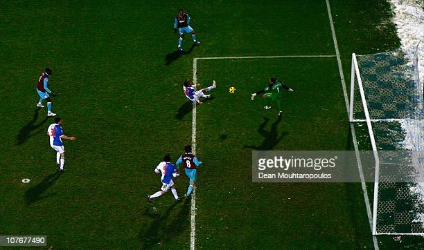 Goalkeeper Paul Robinson of Blackburn can not save the shotand goal by Junior Stanislas of West Ham during the Barclays Premier League match between...