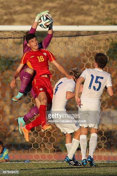 Goalkeeper Paul Woolston from England save the ball as Nehar Sadiki from Macedonia looks on during the England v Macedonia UEFA U17 Qualifier match...