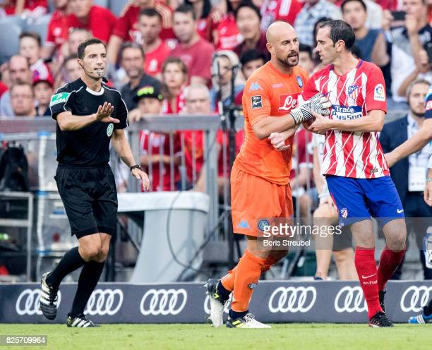 Goalkeeper Pepe Reina of SSC Napoli reacts with Diego Godin of Atletico Madrid after Godín receives a red card during the Audi Cup 2017 match between...