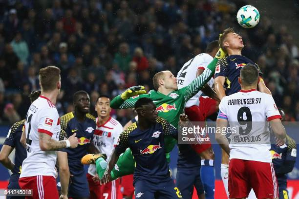 Goalkeeper Peter Gulacsi and Willi Orban of Leipzig clear the ball ahead of Walace of Hamburg during the Bundesliga match between Hamburger SV and RB...
