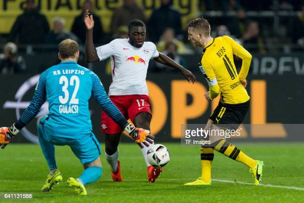 Goalkeeper Peter Gulacsi of RB Leipzig Dayot Upamecano of RB Leipzig and Marco Reus of Borussia Dortmund battle for the ball during the Bundesliga...