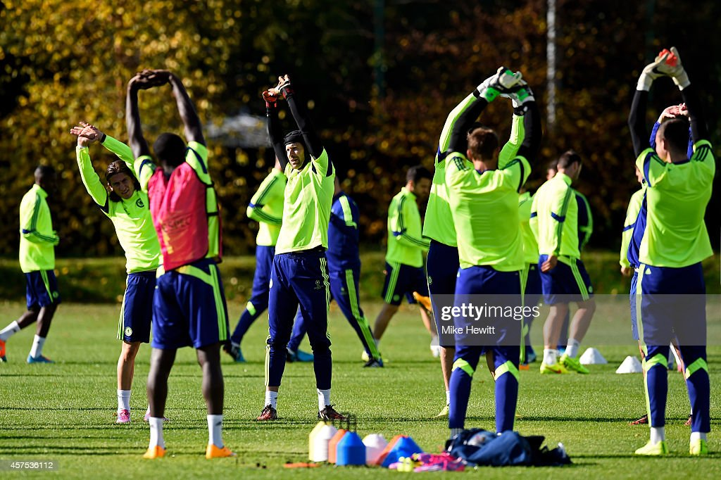Goalkeeper Petr Cech and teammates warm up during the Chelsea FC training session ahead of the UEFA Champions League Group G match against NK Maribor...