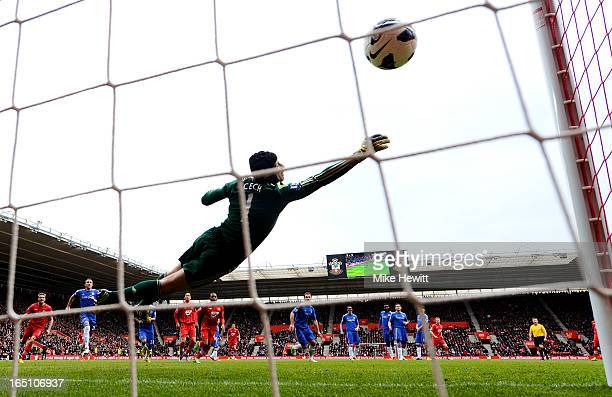 Goalkeeper Petr Cech of Chelsea dives in vain as Rickie Lambert of Southampton scores his team's second goal from a free kick during the Barclays...