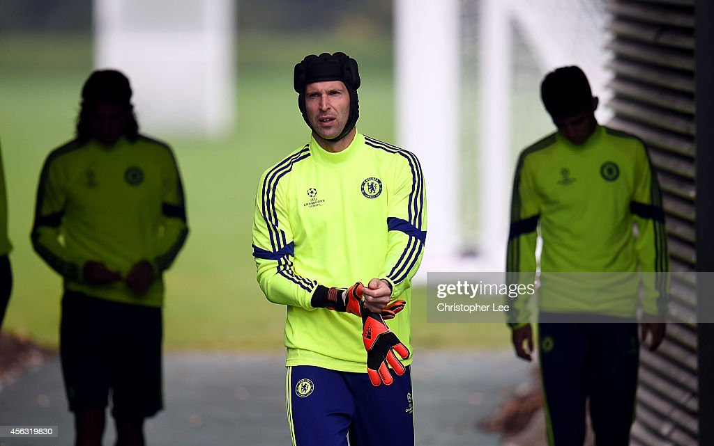 Goalkeeper Petr Cech walks out onto the pitch during the Chelsea Training Session at Chelsea Training Ground on September 29, 2014 in Cobham, England.