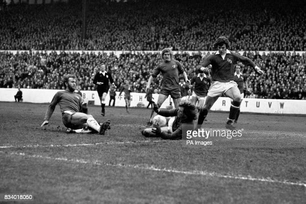 QPR goalkeeper Phil Parkes dives to smother a shot from Chelsea's Tommy Baldwin watched by Ian Gillard and Garland during the 3rd round FA cup match