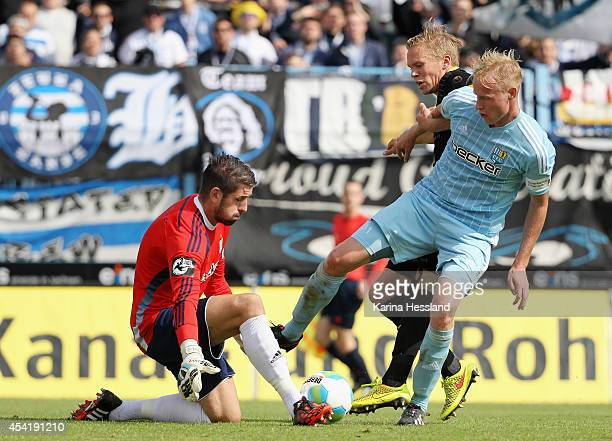 Goalkeeper Philipp Pentke and Tom Scheffel of Chemnitz challenges Dennis Grote of Duisburg during the Third league match between Chemnitzer FC and...