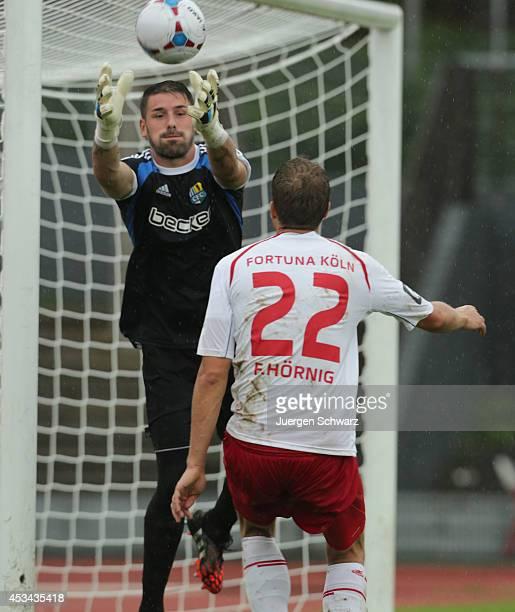 Goalkeeper Philipp Pentke of Chemnitz grabs the ball near Florian Hoernig of Fortuna during the Third Bundesliga match between Fortuna Koeln and...