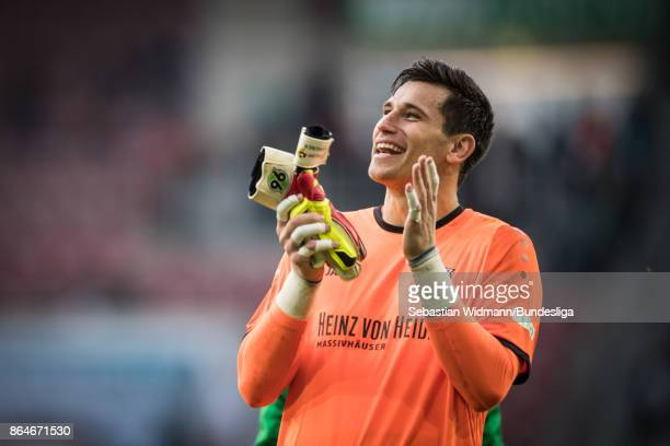Goalkeeper Philipp Tschauner of Hannover 96 smiles after the Bundesliga match between FC Augsburg and Hannover 96 at WWKArena on October 21 2017 in...