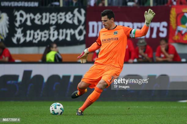 Goalkeeper Philipp Tschauner of Hannover controls the ball during the Bundesliga match between FC Augsburg and Hannover 96 at WWKArena on October 21...