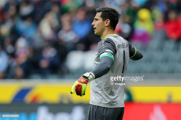 Goalkeeper Philipp Tschauner of Hannover gestures during the Bundesliga match between Borussia Moenchengladbach and Hannover 96 at BorussiaPark on...