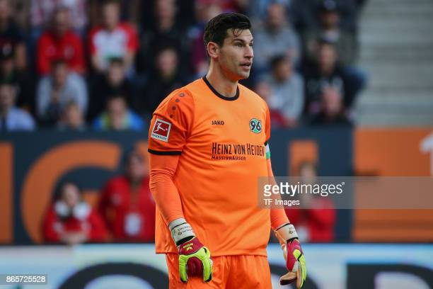 Goalkeeper Philipp Tschauner of Hannover looks on during the Bundesliga match between FC Augsburg and Hannover 96 at WWKArena on October 21 2017 in...