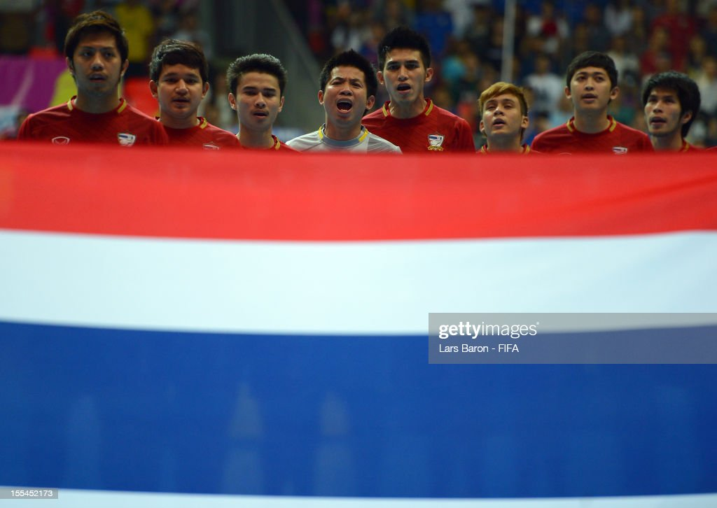 Goalkeeper Prakit Dankhunthod of Thailand and his team mates are sinning the national anthem during the FIFA Futsal World Cup Group A match between Thailand and Ukraine at Indoor Stadium Huamark on November 4, 2012 in Bangkok, Thailand.