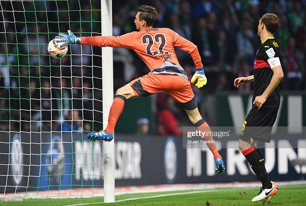 Goalkeeper Przemyslaw Tyton of Stuttgart fails to stop Federico Barba of Stuttgart from scoring an own goal for Werder Bremen's second goal during...