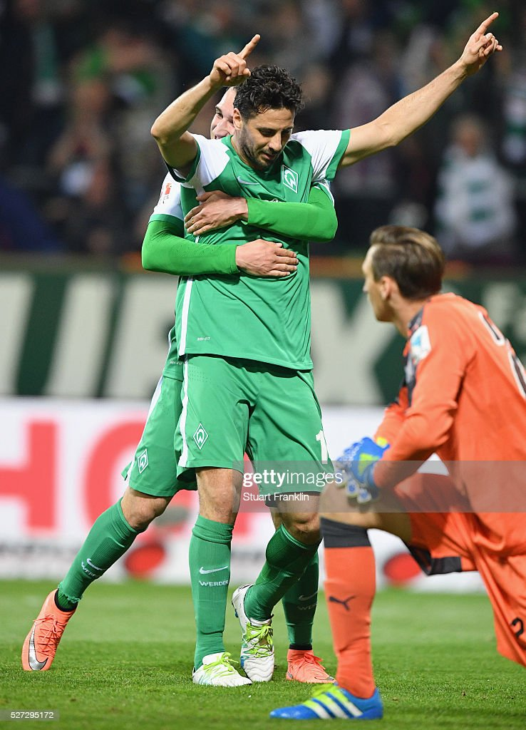 Goalkeeper Przemyslaw Tyton of Stuttgart looks dejected as Claudio Pizarro of Werder Bremen celebrates as he scores their fourth goal during the Bundesliga match between Werder Bremen and VfB Stuttgart at Weserstadion on May 2, 2016 in Bremen, Germany.