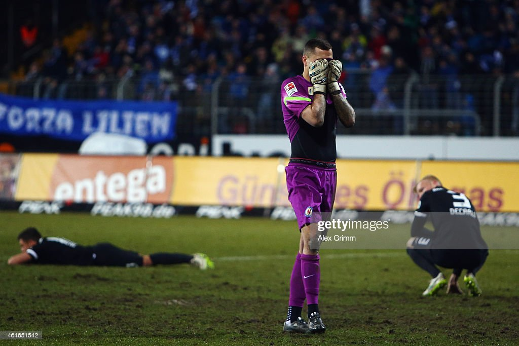 Goalkeeper Rafal Gikiewicz of Braunschweig and team mates react after the Second Bundesliga match between SV Darmstadt 98 and Eintracht Braunschweig...