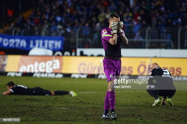 Goalkeeper Rafal Gikiewicz of Braunschweig and team mates react after the Second Bundesliga match between SV Darmstadt 98 and Eintracht Braunschweig...