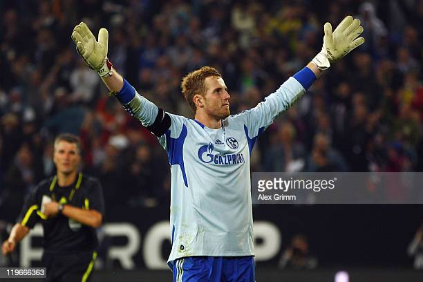 Goalkeeper Ralf Faehrmann of Schalke celebrates after winning the Supercup match against Borussia Dortmund at Veltins Arena on July 23 2011 in...