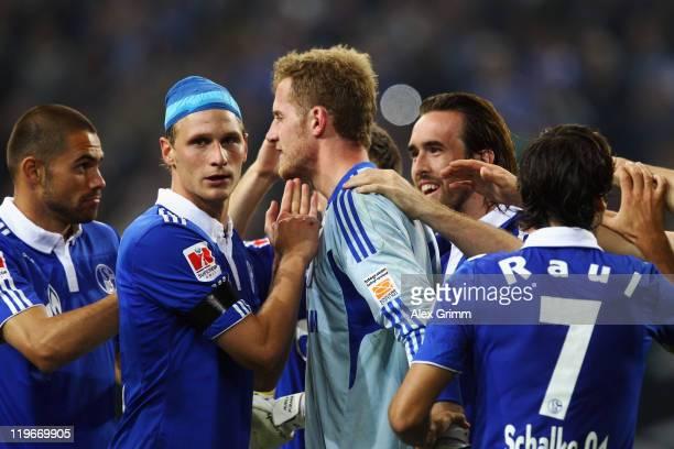 Goalkeeper Ralf Faehrmann of Schalke celebrates with team mates Edu Benedikt Hoewedes Christian Fuchs and Raul after winning the Supercup match...