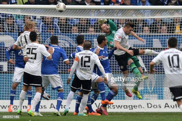 Goalkeeper Ralf Faehrmann of Schalke saves the ball from a corner kick during the Bundesliga match between FC Schalke 04 and Eintracht Braunschweig...