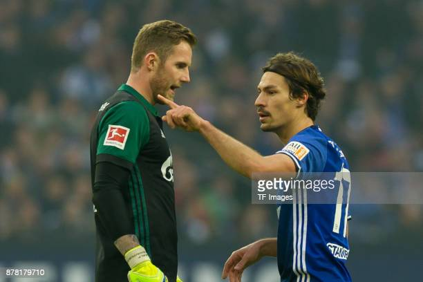 Goalkeeper Ralf Faehrmann of Schalke speak with Benjamin Stambouli of Schalke during the Bundesliga match between FC Schalke 04 and Hamburger SV at...
