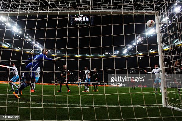 Goalkeeper Ralf Faehrmann of Schalke watches the ball hit the goal post during the Bundesliga match between Eintracht Frankfurt and FC Schalke 04 at...