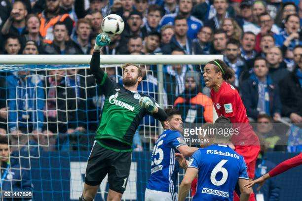 Goalkeeper Ralf Faehrmannof Schalke and Yussuf Poulsen of Leipzig battle for the ball during the Bundesliga match between FC Schalke 04 and RB...