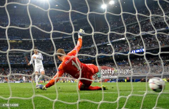 Goalkeeper Ralf Fahrmann of Schalke dives in vain as Alvaro Morata of Real Madrid scores his team's third goal during the UEFA Champions League Round...