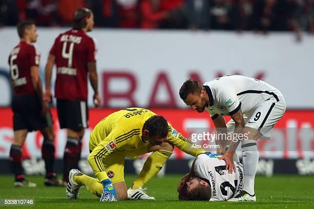Goalkeeper Raphael Schaefer of Nuernberg and Haris Seferovic of Frankfurt look after Marc Stendera of Frankfurt during the Bundesliga Playoff Leg 2...
