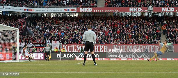 Goalkeeper Raphael Schaefer of Nuernberg parries the second penalty of Braunschweig shot by Ermin Bicakcic during the Bundesliga match between 1 FC...