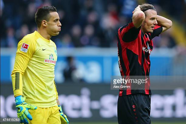Goalkeeper Raphael Wolf of Bremen and Alexander Meier of Frankfurt react during the Bundesliga match between Eintracht Frankfurt and Werder Bremen at...