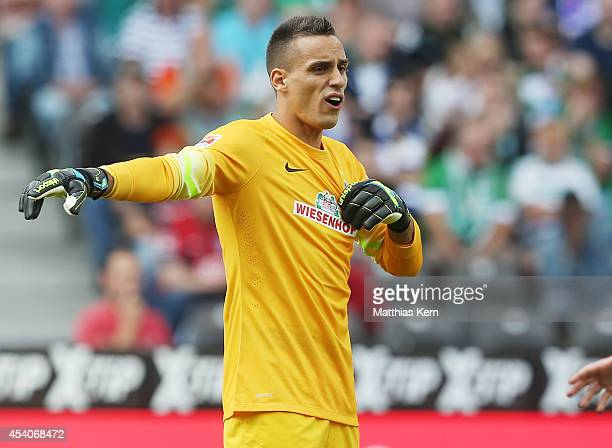 Goalkeeper Raphael Wolf of Bremen gestures during the Bundesliga match between Hertha BSC and SV Werder Bremen at Olympiastadion on August 23 2014 in...