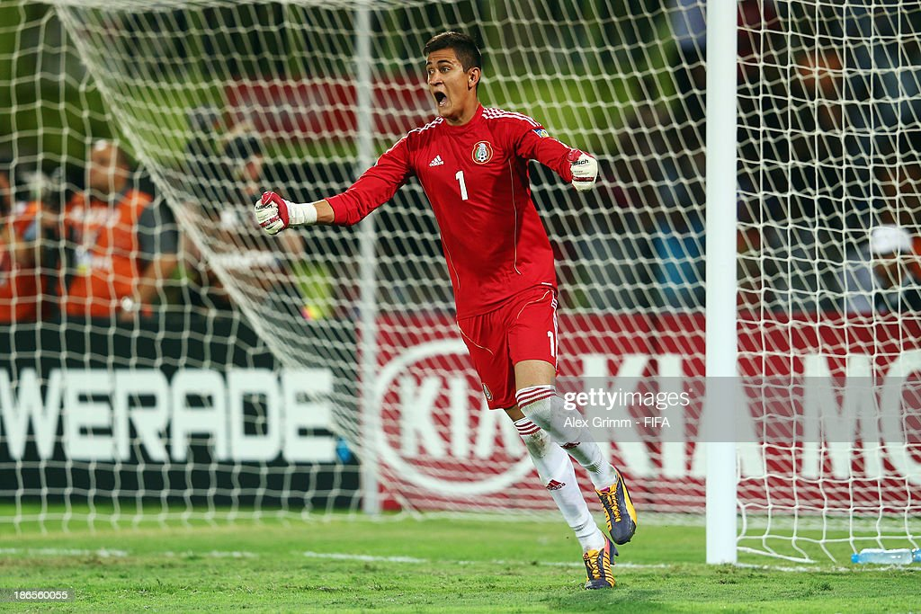 Goalkeeper Raul Gudino of Mexico celebrates after saving the penalty of Mosquito of Brazil during the penalty shootout of the FIFA U-17 World Cup UAE 2013 Quarter Final match between Brazil and Mexico at Al Rashid Stadium on November 1, 2013 in Dubai, United Arab Emirates.