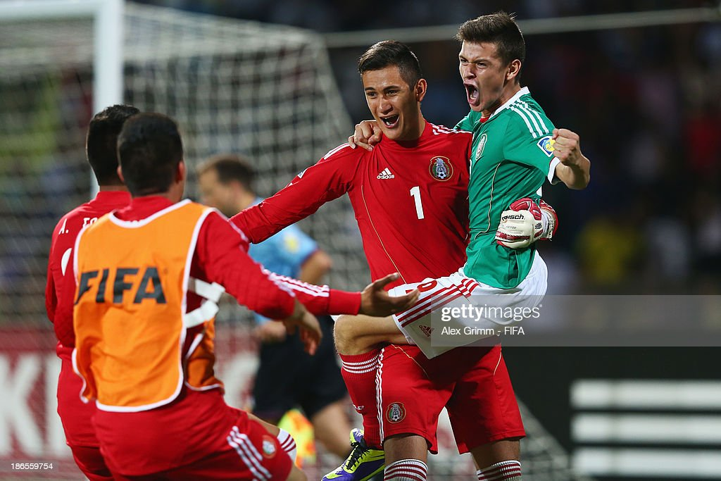 Goalkeeper Raul Gudino of Mexico celebrates with team mate Alejandro Diaz (R) after winning the penalty shootout during the FIFA U-17 World Cup UAE 2013 Quarter Final match between Brazil and Mexico at Al Rashid Stadium on November 1, 2013 in Dubai, United Arab Emirates.